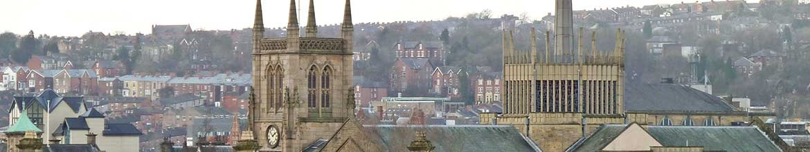 Blackburn Cathedral from the canal towpath; railway station roof in the foreground United Kingdom
